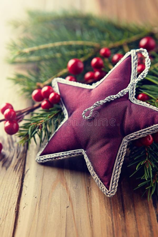 Vintage christmas star on natural spruce twigs stock photos