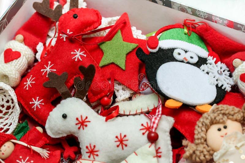 Vintage christmas tree festive felt decorations toys bacground. Winter holiday concept, handmade craft stock photo