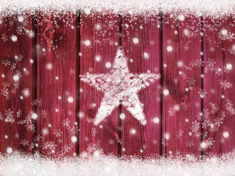 Christmas winter holiday snow star background with snowflakes on wooden texture with snow frame stock photography