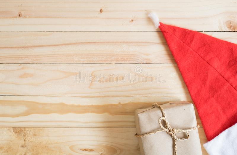 Vintage Christmas wood background with gifts, red hat. And copy space stock photography
