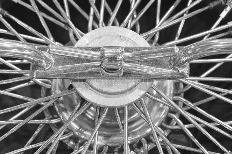 Vintage chrome hubcap detail in black and white. Horizontal royalty free stock images