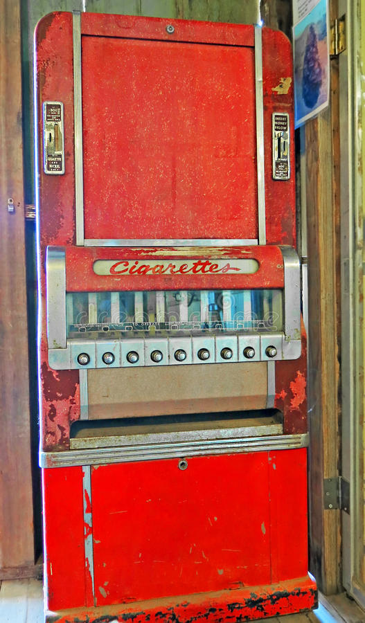 Vintage Cigarette Vending Machine. An old push button coin operated cigarette vending machine - a pack was selling for 30 cents royalty free stock photo