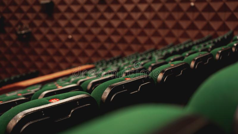 Vintage cinema theater movies audience retro seating seats, green, nobody. Vintage cinema theater movies audience retro seating seats, green and brown, nobody royalty free stock photo