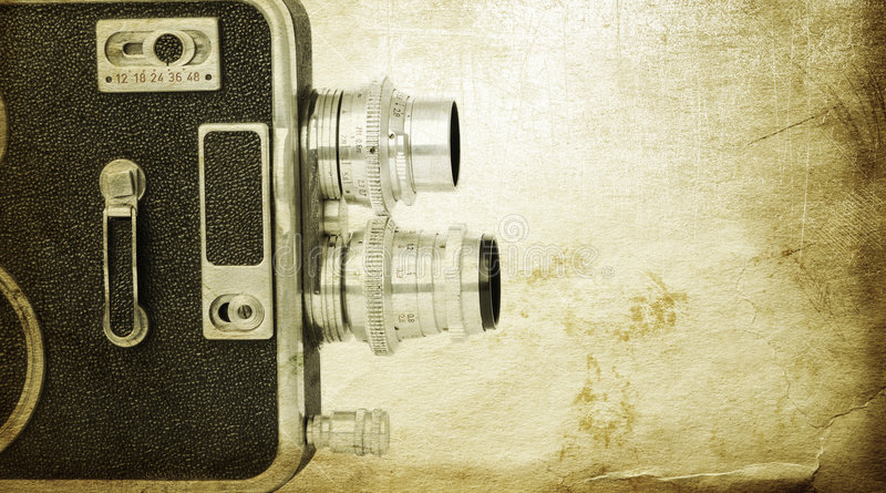 Vintage cinematography. Old retro camera special textured with grunge background royalty free stock images