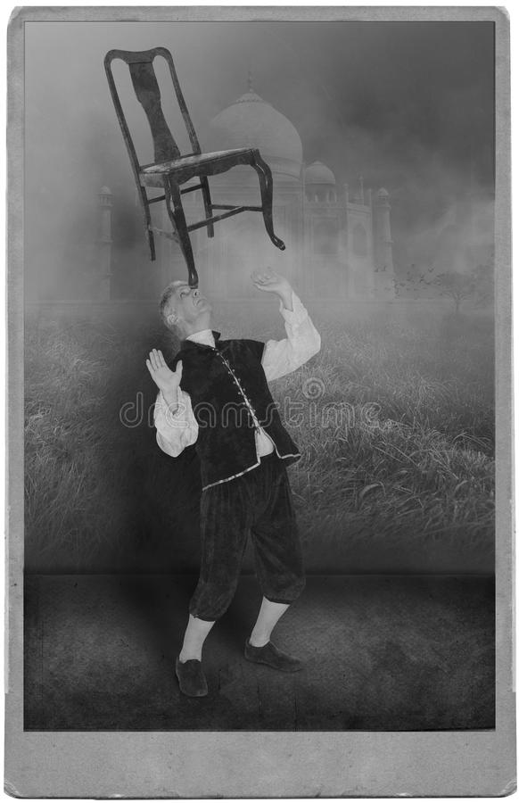 Vintage Circus Performer, Carnival Act, Show. Photograph portrait of a vintage circus or carnival performer in a midway or freak show. The man is balancing a stock image
