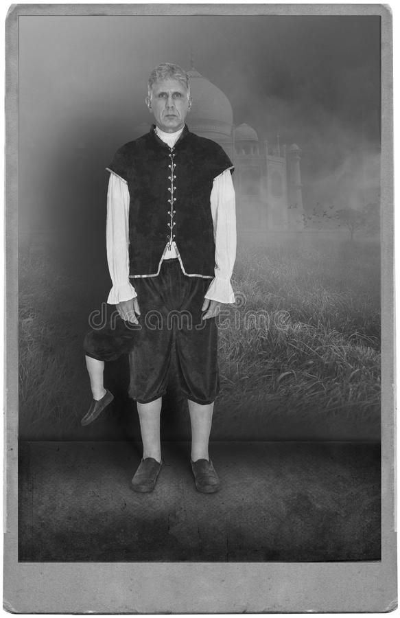 Vintage Circus Performer, Carnival, Freak Show. Photograph portrait of a vintage circus or carnival performer in a freak show. The man has three legs. The retro royalty free stock photography