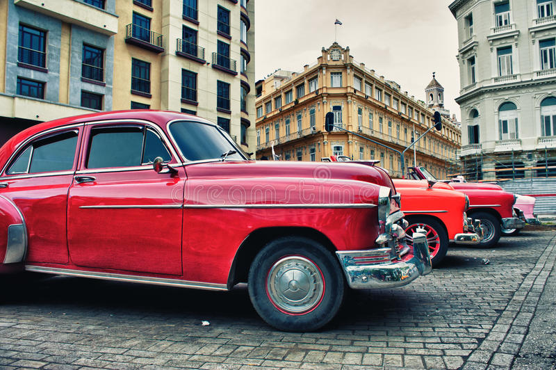 Vintage classic american cars parked in a street of Old Havana stock image
