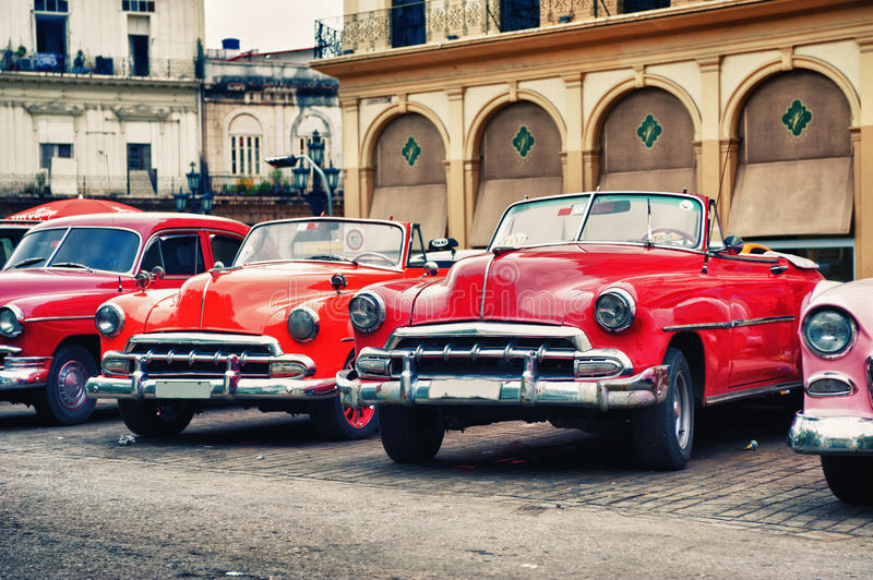 Vintage classic american cars parked on a street of Old Havana royalty free stock photos