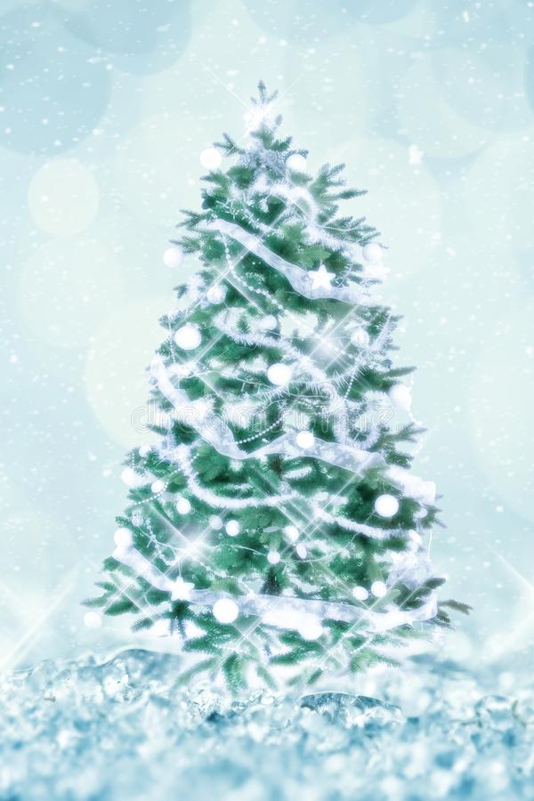 Vintage classic Christmas tree with white ornaments, shiny lights, white snow and bokeh background holiday greeting card royalty free stock photos