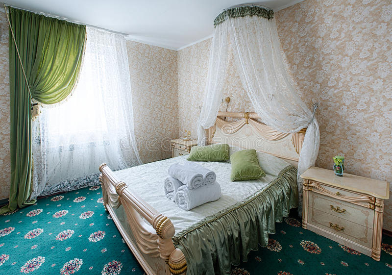 Vintage classic hotel bedroom interior. Bedroom interior design. Vintage bedroom, elegant and luxurious. Hotel premium luxurious classic interior. Double bed royalty free stock photography