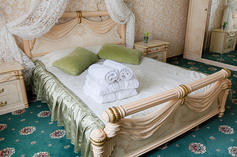 Vintage classic hotel bedroom interior. Bedroom interior design. Vintage bedroom, premium and luxurious. Hotel classic interior. Double bed with canopy and royalty free stock images