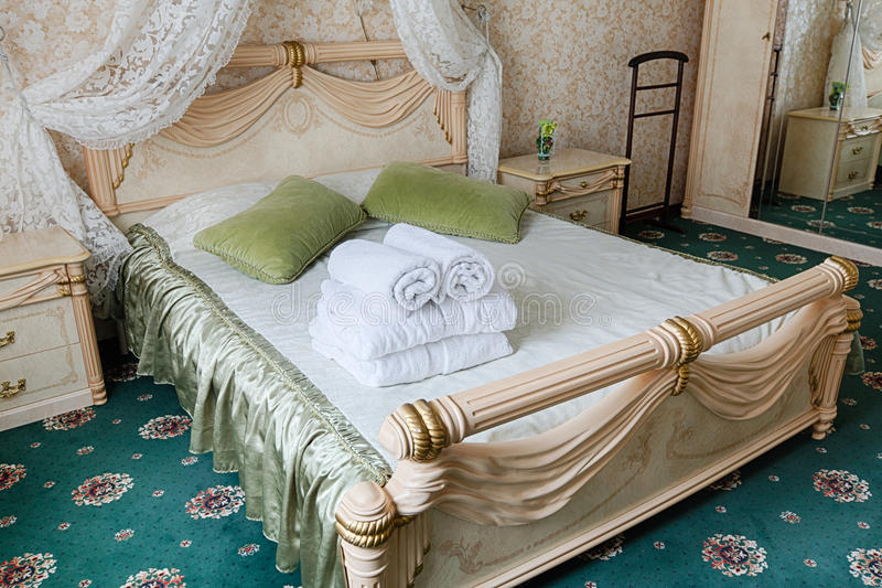 Vintage classic hotel bedroom interior. Bedroom interior design. Vintage bedroom, premium and luxurious. Hotel classic interior. Double bed with canopy and royalty free stock image