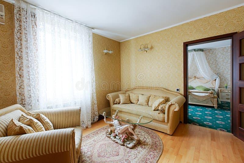 Vintage classic hotel room interior. Luxurious hotel suite premium interior design. Vintage bedroom, elegant and luxurious. Hotel classic interior. Sofa, table stock photo