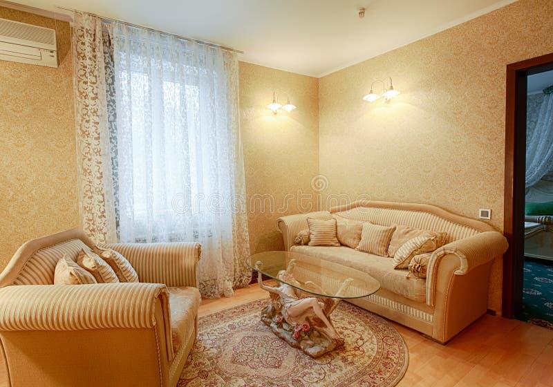 Vintage classic hotel room interior. Luxurious hotel suite premium interior design. Vintage bedroom, elegant and luxurious. Hotel classic interior. Sofa, table royalty free stock photos