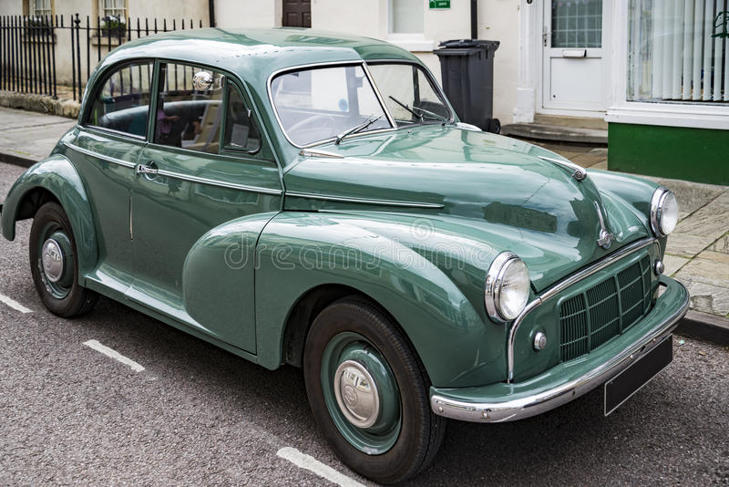Vintage Classic Morris Minor. CORSHAM - UNITED KINGDOM - JULY 17: Vintage Classic Morris Minor in small village in south of England on July 17, 2015 in Corsham royalty free stock photos