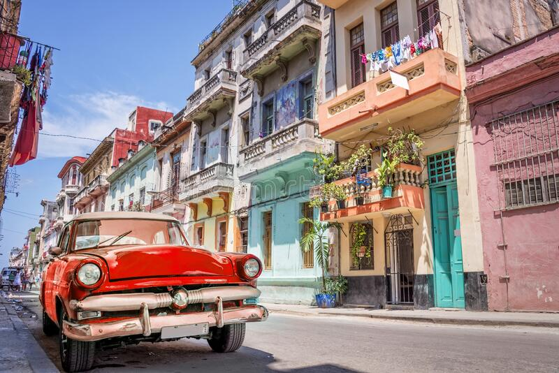 Vintage classic red american car in a colorful street of Havana Cuba. Vintage classic red american car in a colorful street of Havana, Cuba royalty free stock image