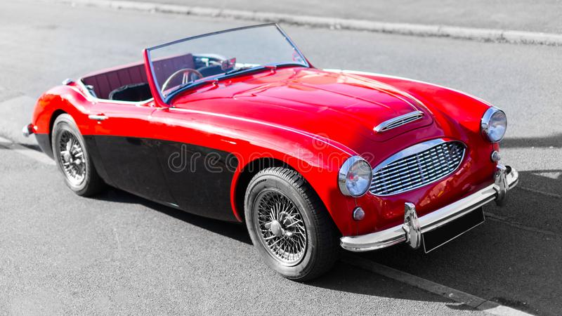 Vintage classic red retro convertible sports car royalty free stock images