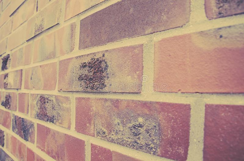 Vintage clinker brick wall background. Wall of clinker bricks with marks of mortar. Angle approach with old photograph effect stock photography