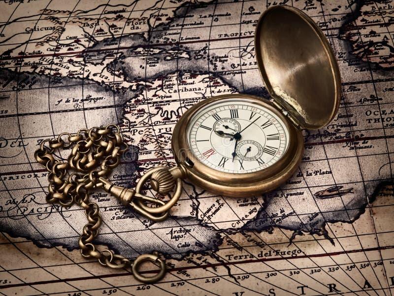 Vintage clock at antique map