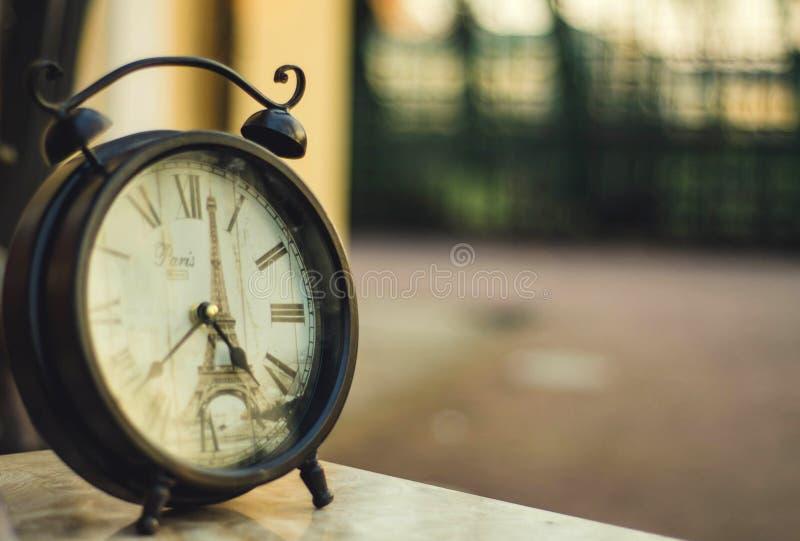 Vintage clock about Paris stock photos
