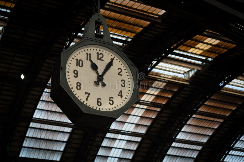 Vintage clock. At rail station royalty free stock image