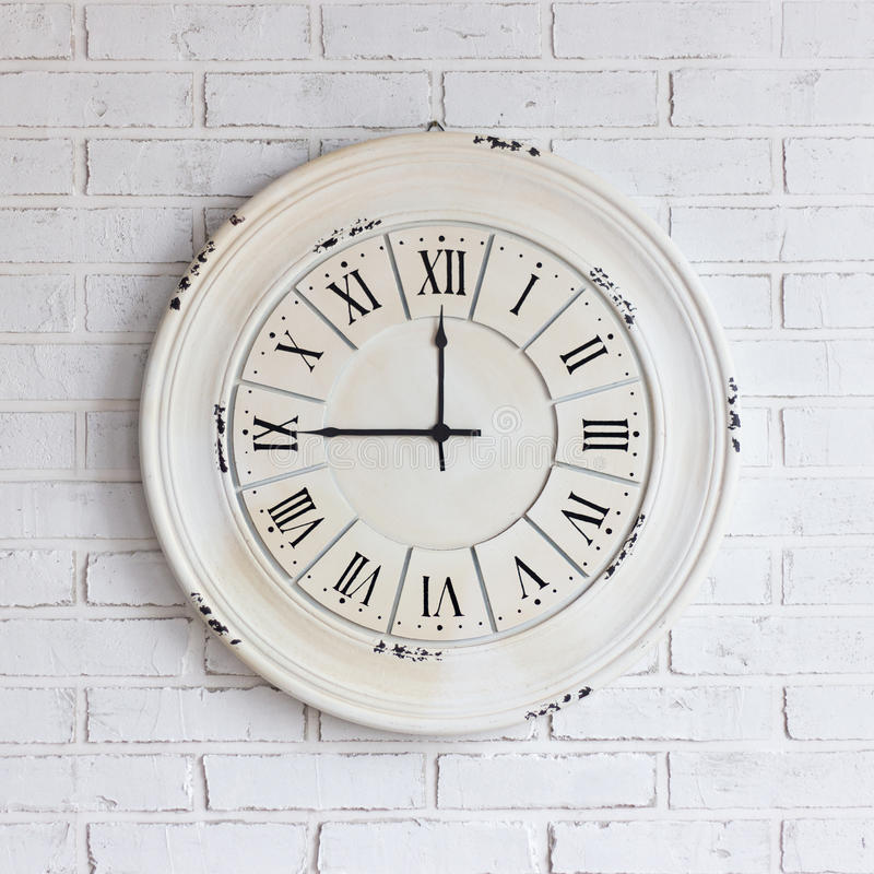 Vintage clock on white brick wall royalty free stock images