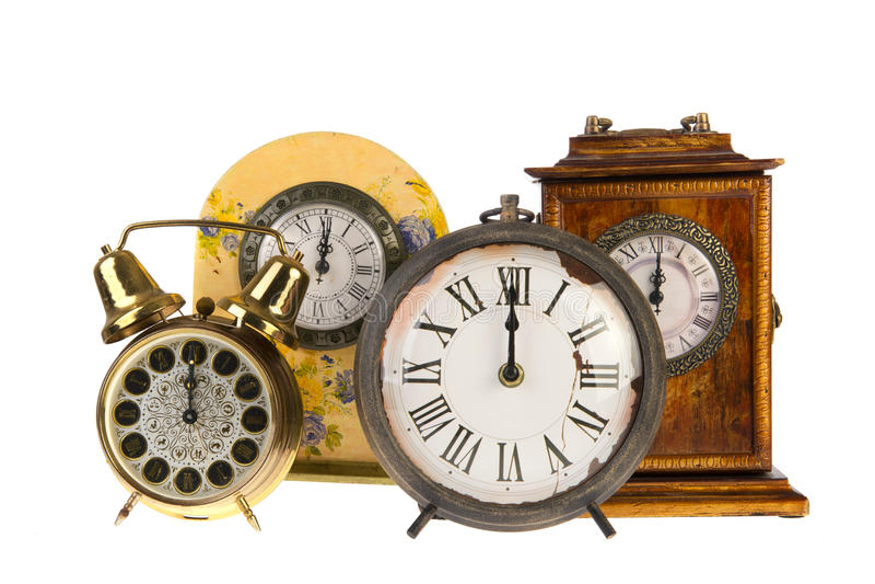 Vintage clocks at twelve royalty free stock photo