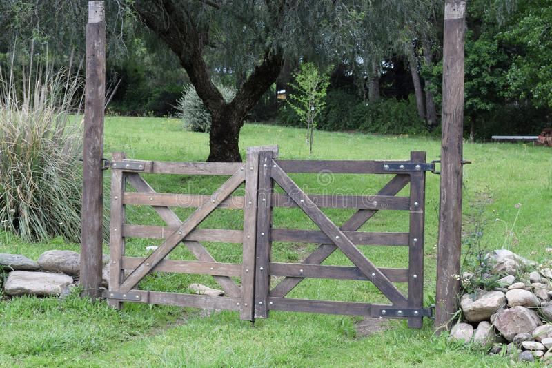 Vintage closing wooden gate on a farm in the village stock photos