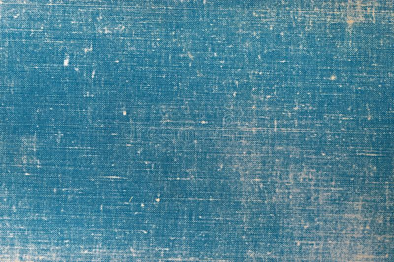 Vintage cloth book cover with a blue screen pattern and grunge background textures. stock images