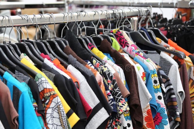 Vintage clothes of many colors for sale at flea market. Retro and vintage clothes of many colors for sale at flea market royalty free stock photos