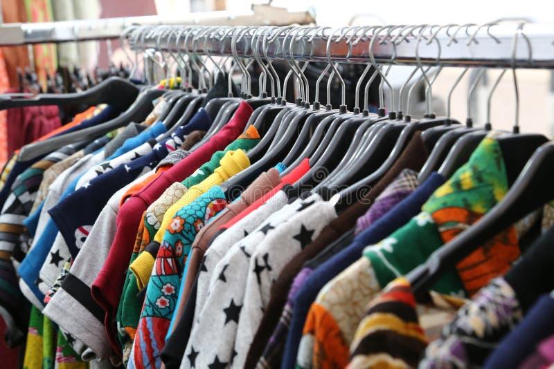 Vintage clothes for sale at flea market stock photos