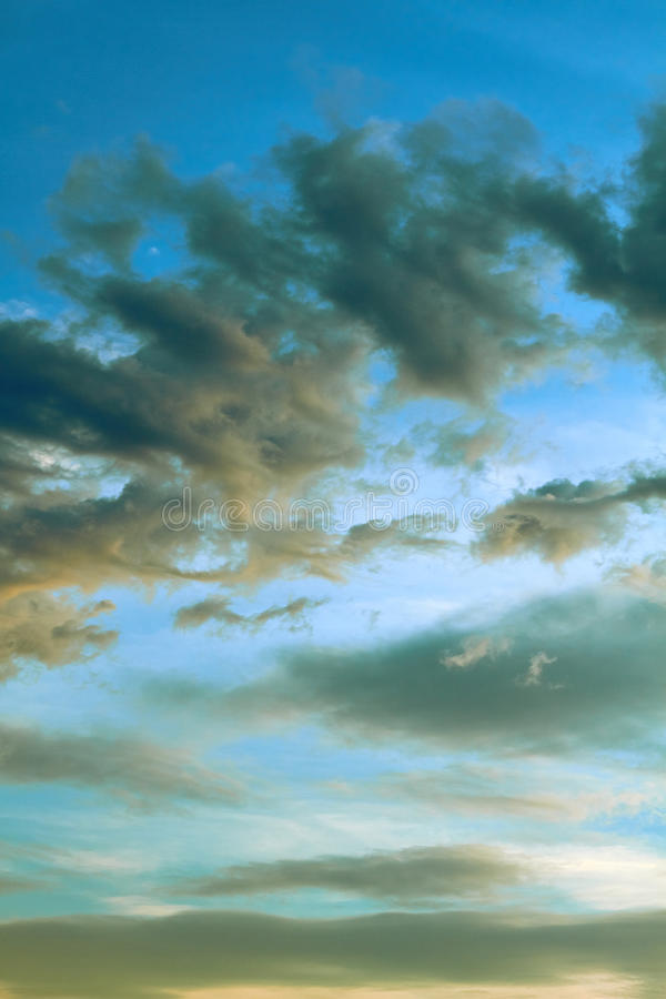 Vintage clouds in the evening sky royalty free stock image