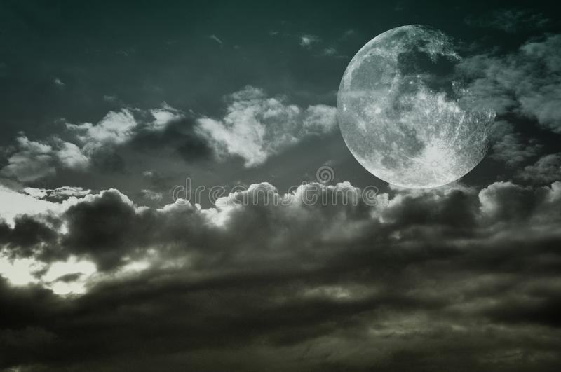 Vintage cloudy sky with full moon. Copy space. Vintage cloudy sky with full moon stock images