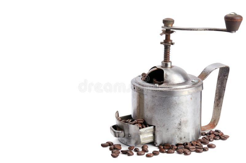 Vintage coffee grinder with coffee beans  on white background. Free space for your text royalty free stock photo
