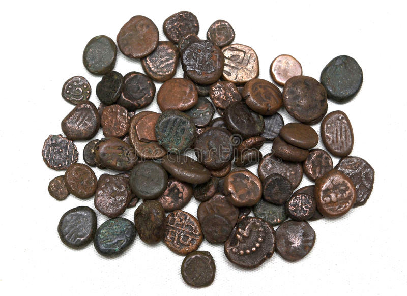 VINTAGE COINS. Old indian vintage coins on display royalty free stock photography