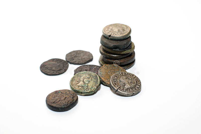 Vintage coins with portraits on a white background. A lot of old coins with portraits of kings on a white background stock photo