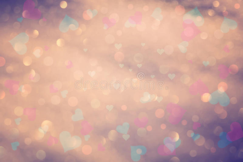 Vintage colorful bokeh with hearts. Vintage color abstract blurred bokeh with colorful heart symbol illustration royalty free stock photos