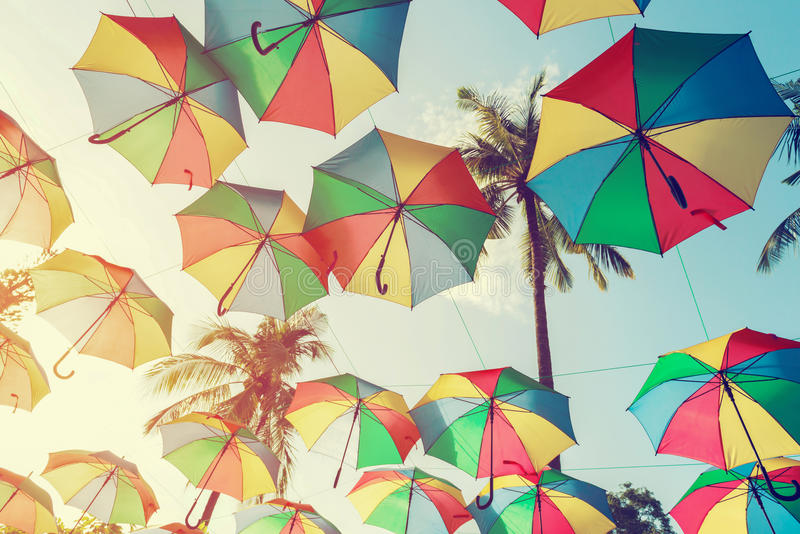 Vintage colorful umbrella on side beach - festival party in summer,. Filter effect royalty free stock images