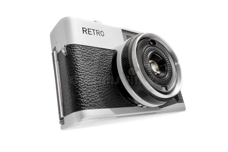 Vintage compact camera isolated on white. Vintage compact camera with the fiction name RETRO and isolated on white stock images