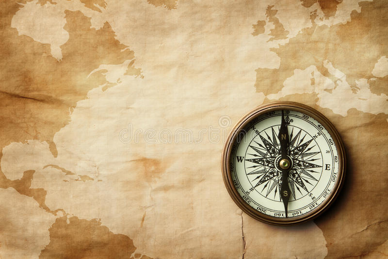 Vintage compass on old map with copy space stock photos
