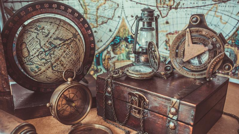 Vintage Compass Wooden Treasure Box Lamp Lighting And Globe Model Old Pirate Collection Photos. Vintage Compass Wooden Treasure Box Lamp Lighting And Earth Globe stock images