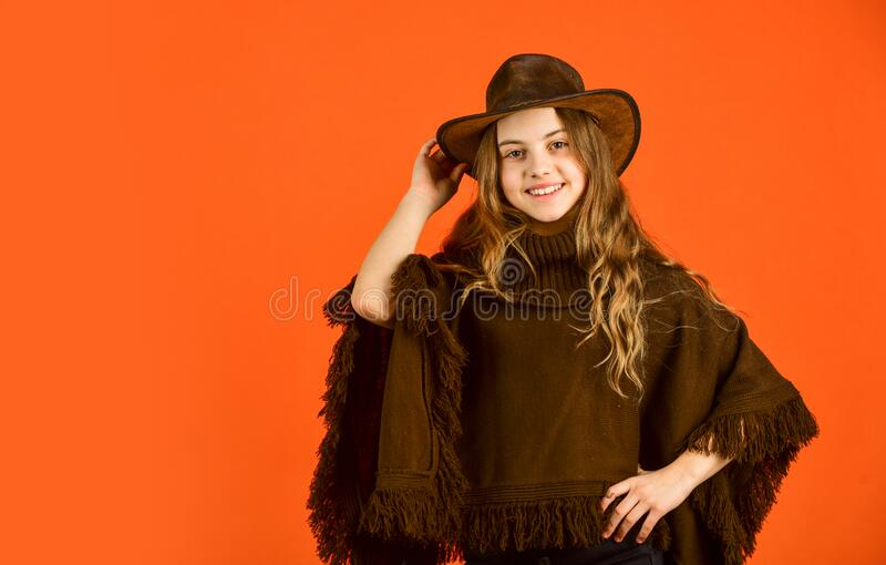 Vintage concept. confident and ambitious. teen in hat. stylish looking girl. small girl wear autumn clothes. retro. Fashion model. beauty and fashion. looking stock photography