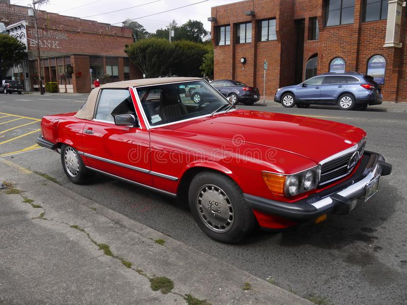 Vintage Convertible Sports Cars. The beautiful vintage red 1989 Mercedes-Benz 560 SL car in Oregon, U.S. Roadster convertible sports classic cars stock photography