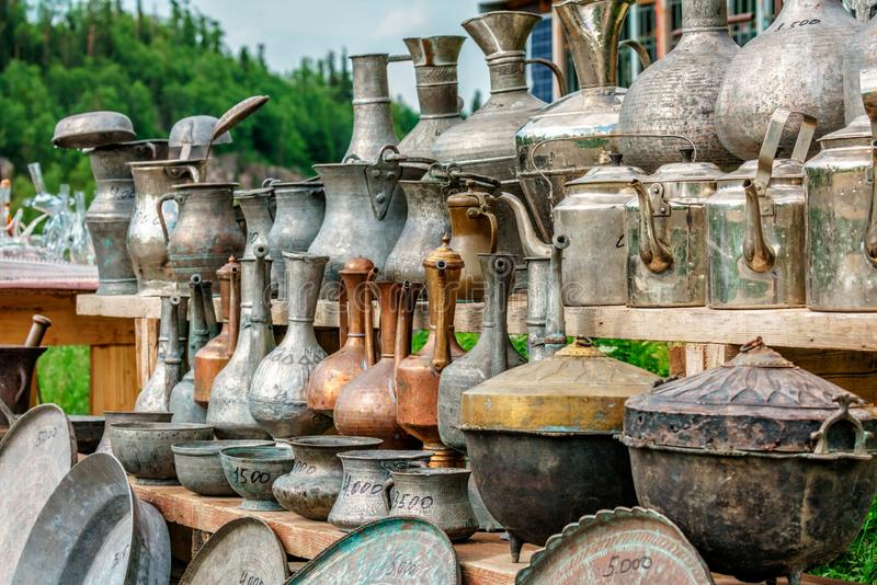 Vintage copper and brass metal pitchers, jugs, trays and other different antique handicraft household ware of ancient Caucasus stock photos