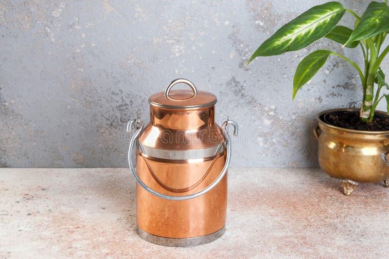Vintage copper milk can stock photo