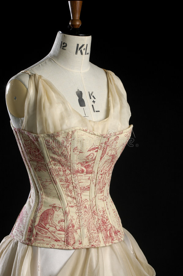 Vintage corset and dress on a models dummy royalty free stock images