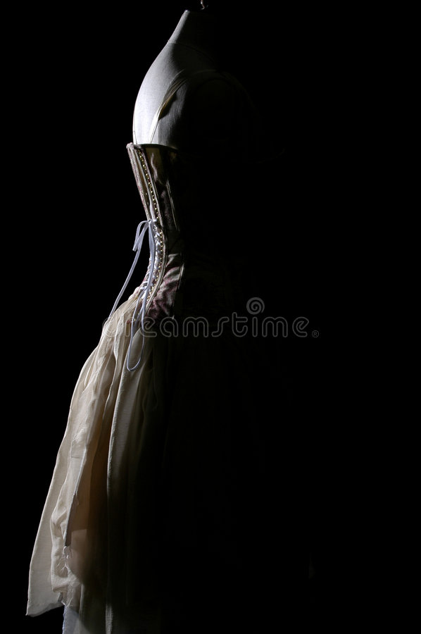 Vintage corset and dress on a models dummy royalty free stock photography