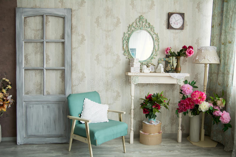 Vintage country house interior with mirror and a table with a va stock image