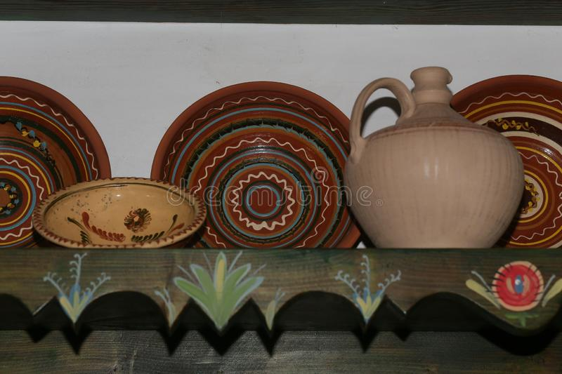 Vintage crockery pottery clay plates patterns. Vintage crockery pottery clay plates with patterns, design, decoration, tableware, earthenware, brown, culture royalty free stock images