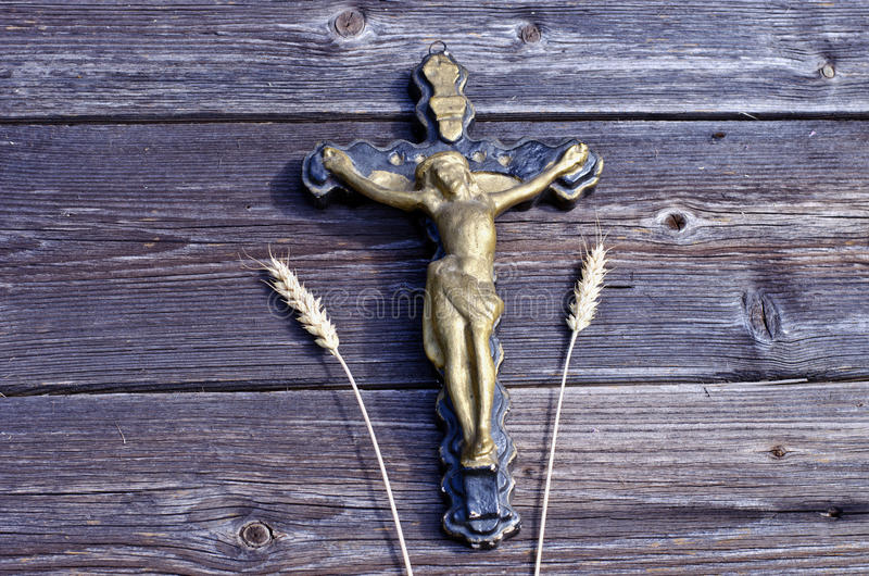 Vintage cross crucifixion with Jesus on old wooden background royalty free stock images